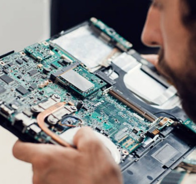 Worker inspecting a computer board
