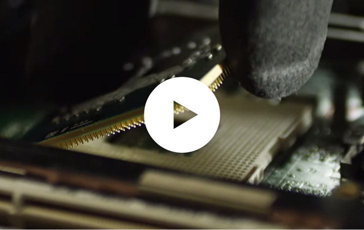 A close-up of a processor being removed from a motherboard.